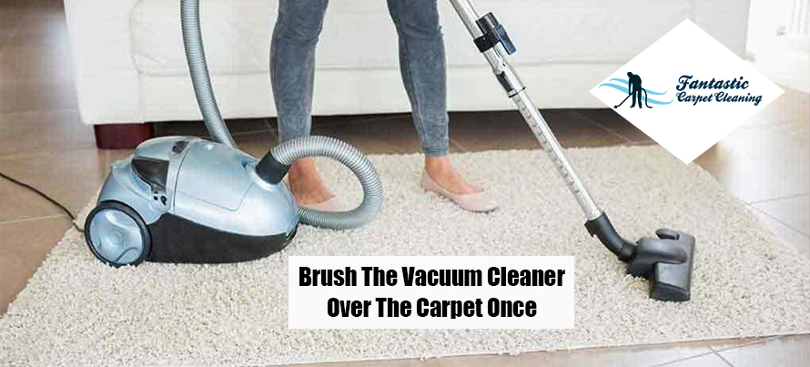 Brush Vacuum Cleaner over the Carpet